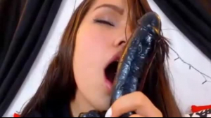 Horny college girl licking her sex toy and sucking